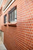 Iron Bars On Windows In Brick Wall