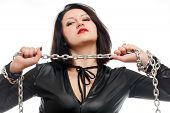 stock photo of sado-masochism  - seductive young girl holding a steel chain on a white background - JPG