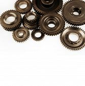 Metal cog wheels bonding together on plain background