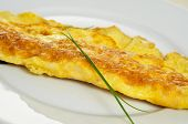 closeup of a french omelette, typical rolled plain omelette