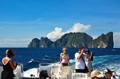 PHI PHI ISLAND,THAILAND - MARCH 06: Thai boat with tourists on turquoise water on March 06,2012 in K