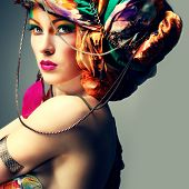 A photo of beautiful redheaded girl in a head-dress from the coloured fabric, glamour