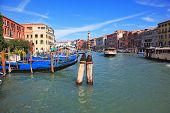 The famous Grand Canal in Venice. Fine sunny day. Vaporetto is transported by thousands delighted tourists. The photo is made a lens the Fish eye
