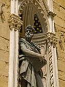 Sculpture Of St. Luke In Facade Of Orsanmichele Church. Florence