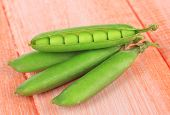 stock photo of sweet pea  - Sweet green peas on wooden background - JPG