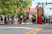 Teenage Boys Compete In Asphalt Basketball Tournament On City Street