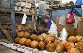 Old Man Shredding Coconut