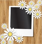 Dais and photo frame on wood background