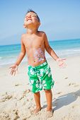 Young boy having fun at the beach