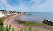 Dawlish Devon England with railway track and sea on blue sky summer day