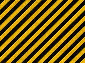 Seamless Background Pattern With Yellow And Black Diagonal Lines On Concrete Wall