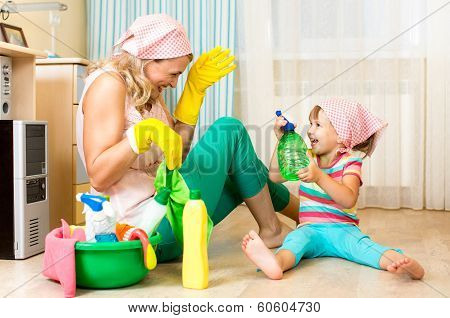 Happy Mother With Kid Cleaning Room And Having Fun poster