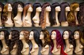 stock photo of mannequin  - a row of mannequins on a shelf in a wig shop