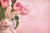 Easter bunny and tulips on pink background