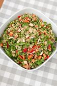 Organic Vegan Quinoa Salad with hazelnuts, arugula salad and red pepper
