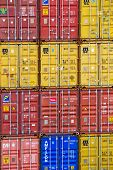 Stack of brightly coloured shipping containers