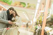 Young Couple Buying Wine