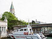 stock photo of coast guard  - A coast guard boat in Venice canal with Saint Marks Tower in Background - JPG