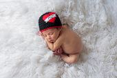 pic of beanie hat  - Nine day old sleeping baby boy wearing a crocheted  - JPG