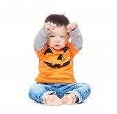 Asia baby boy with halloween dressing and hands up