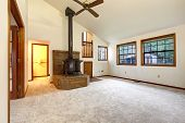 stock photo of vault  - Farm house living room with vaulted ceiling and carpet floor - JPG