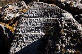 Nepalian hieroglyph on stone