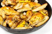 Frying Pan with Roasted chicken.