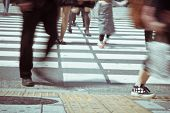 stock photo of pedestrian crossing  - Pedestrians cross at Shibuya Crossing in tokyo - JPG