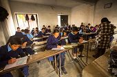 KATHMANDU, NEPAL - DEC 19, 2013: Unknown children in the lesson at public school. Adult literacy (ag