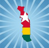 Togo map flag on blue sunburst illustration