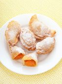 stock photo of patty-cake  - Cakes with fresh apricots on white plate top view - JPG