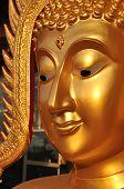 Buda cara Aura latón