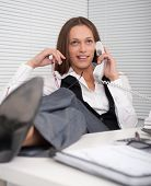 Satisfied Businesswoman Relaxing In His Office