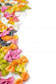 Multicolored farfalle pasta,on the left edge