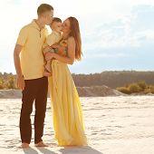 Happy Beautiful Family On The Beach Sunset