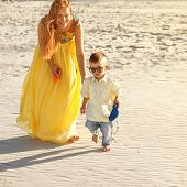Happy Mother And Son On The Beach Sunset