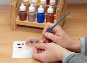 picture of eye-sockets  - Coloring Artificial Silicone Human Eye Isolated on Wooden Table - JPG