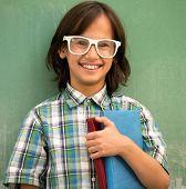 Happy school boy posing for education portrait