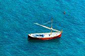 Small Wooden Sailboat At Sea
