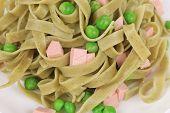 Italian pasta tagliatelle with ham.