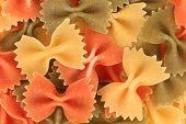 Multicolored italian pasta farfalle.