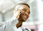 Happy Young Man Calling By Mobile Phone