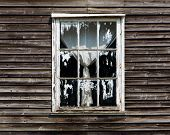 Old Window With A Curtain Of Wooden House