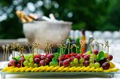 stock photo of fruit platter  - Platter of assorted fresh fruit at buffet table - JPG