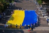 ODESSA, UKRAINE - August 23: Flash mob in city of Odessa on Potemkin Stairs on August 23, 2014, in day of a national flag of Ukraine.