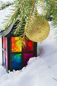 Decorative Lantern In The Snow And Fur-tree Branch With Christmas Ball