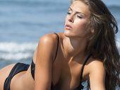 lying on the send beach