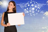 Businesswoman with world map and app icons