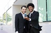 two business men making selfportrait