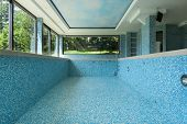 empty pool, interior of a modern house